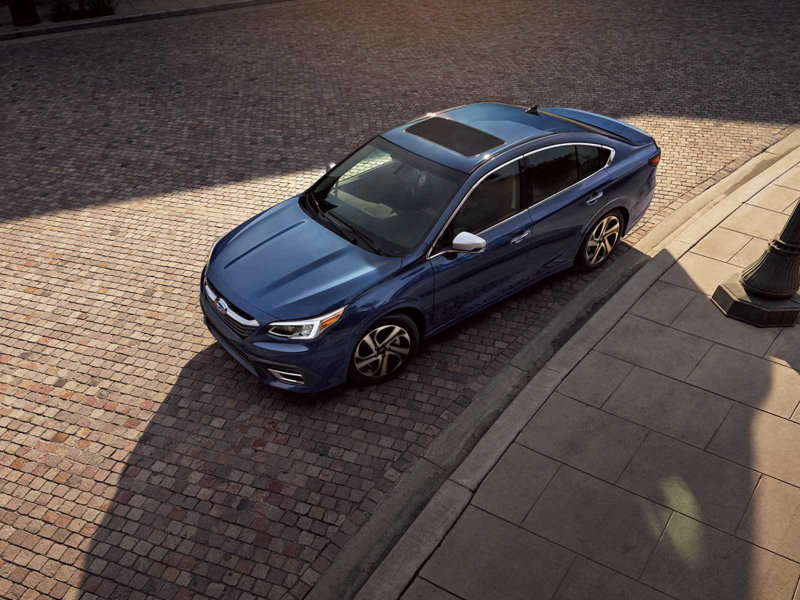 A Subaru Legacy features amazing views near Louisville CO